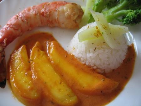 Rcette de gambas au curry d'agrumes, mangue poêlée et riz